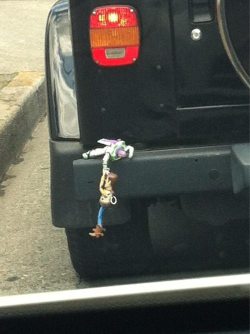 little guys are taking a ride on the back of your car! Hang on Woody ...