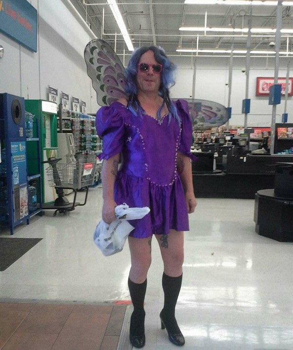 Manly Purple Fairy Godmother With Wings Flapping Around At
